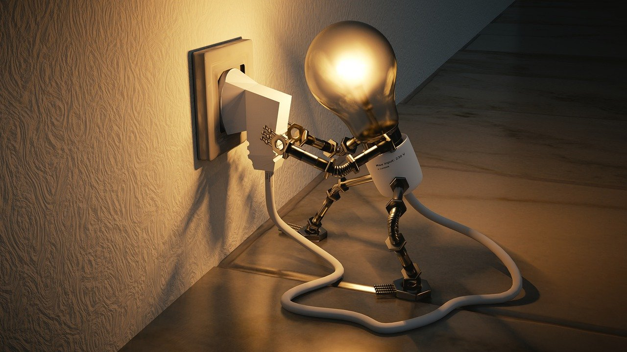 Image of a light bulb plugin itself into the wall